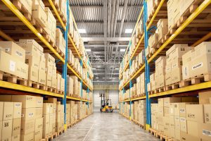 forklift between rows in warehouse